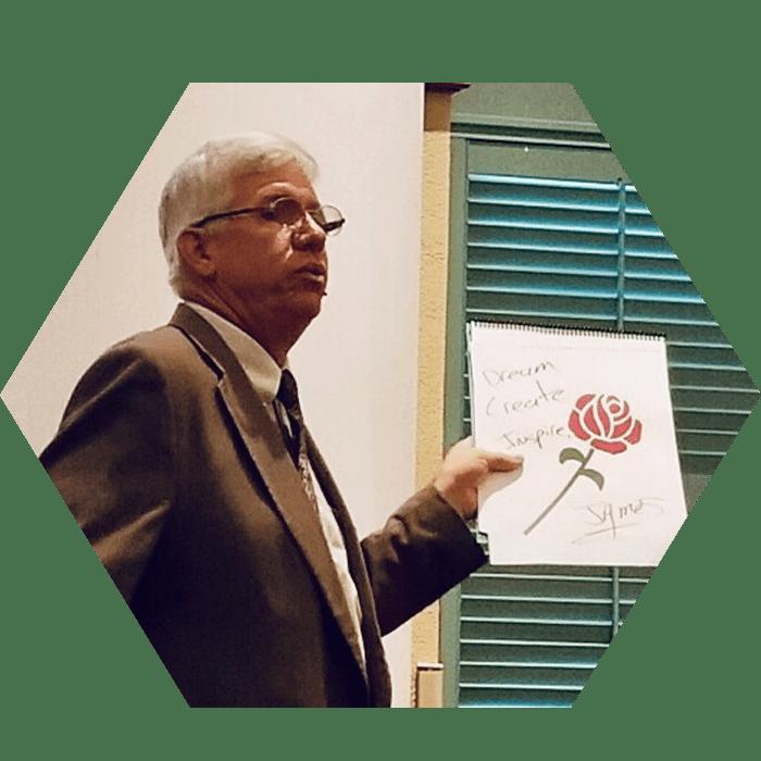 James Songster holding an illustration