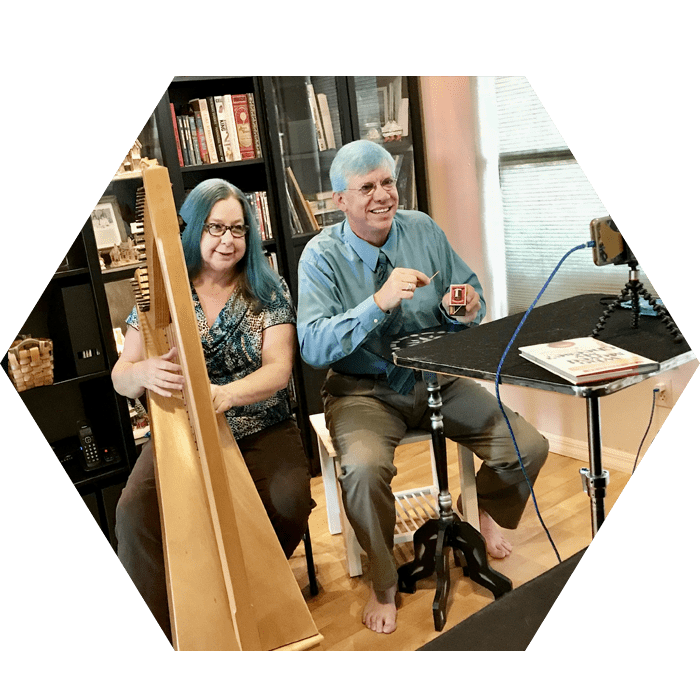 James Songster and a Woman Holding an Instrument
